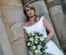 Mature bride with professional makeup and flowers in Lancaster