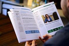 Impact report spread explaining programs