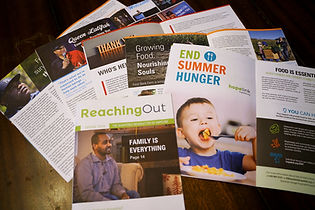 Spreads of newsletter magazines.