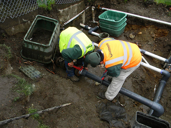 Earthworks Landscape Services, Inc. employees building a custom irrigation system.