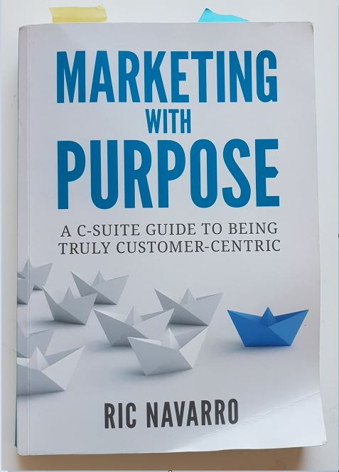 A booked titled Marketing with Purpose by Ric Navarro