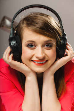 Technology, music and happiness concept - smiling girl teenage in headphones listening music