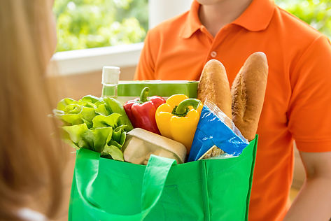 Grocery store delivery man wearing orang