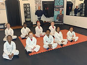 Kids group picture sitting down.jpg