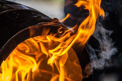 Fire burning in a wooden barrel.jpg
