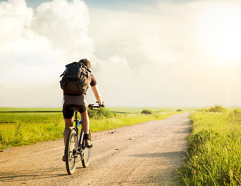Stock image of an active guy riding his bicycle