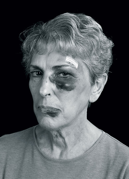 Model portraying domestic violence from the NOT in our Town campaign
