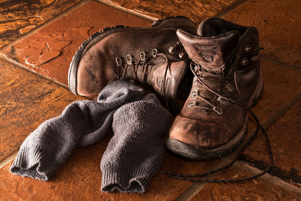 worn boots and socks on the floor