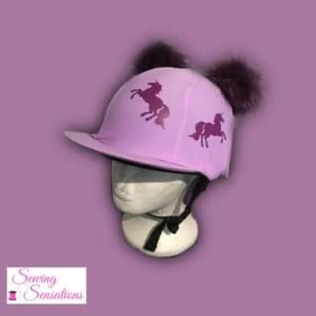 Lilac hat silk with purple unicorns and matching Pom Poms
