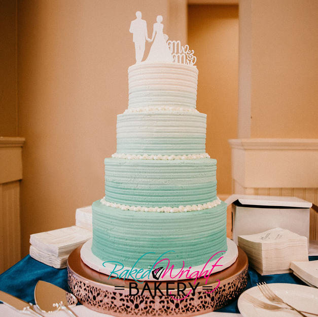 wedding cake 9.9.18 with logo.jpg