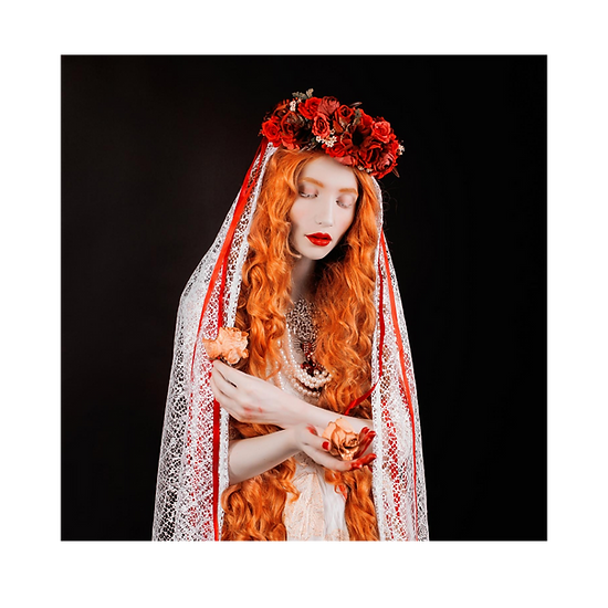 Red haired woman with a headress and lace veil holding a rose