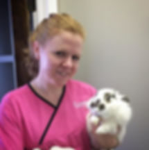 Stacy, one of our wonderful registered veterinary technicians giving a super cute bunny a cuddle. 💜