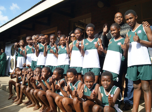 Comrades and Sports Trust handover sports kit to learners