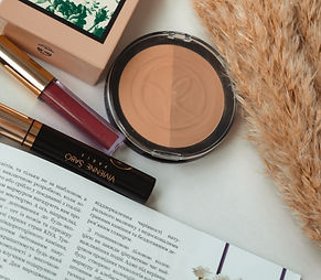 Makeup and bronzer on a table