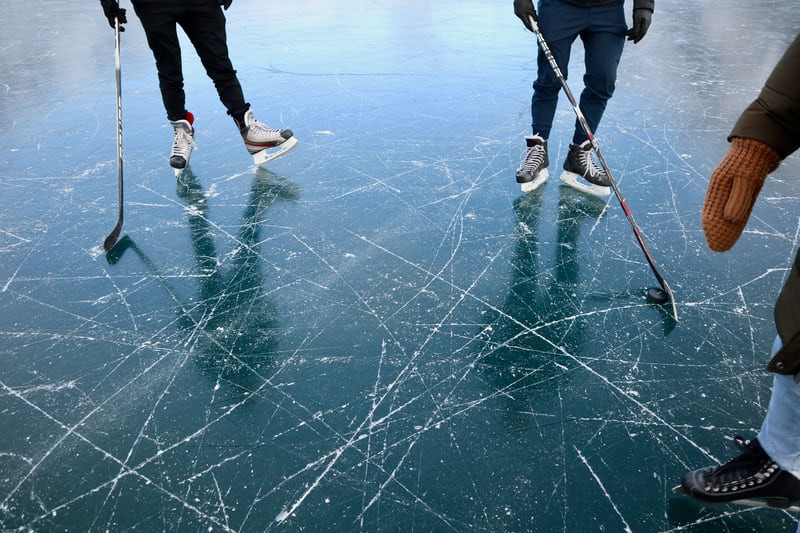 skating outdoors hockey lake frozen ice