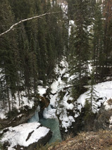 frozen waterfall into streaming water