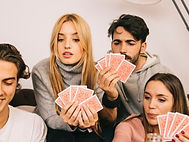happy-friends-playing-cards-game_23-2147