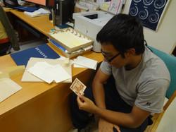 Ibrahim examining old photos