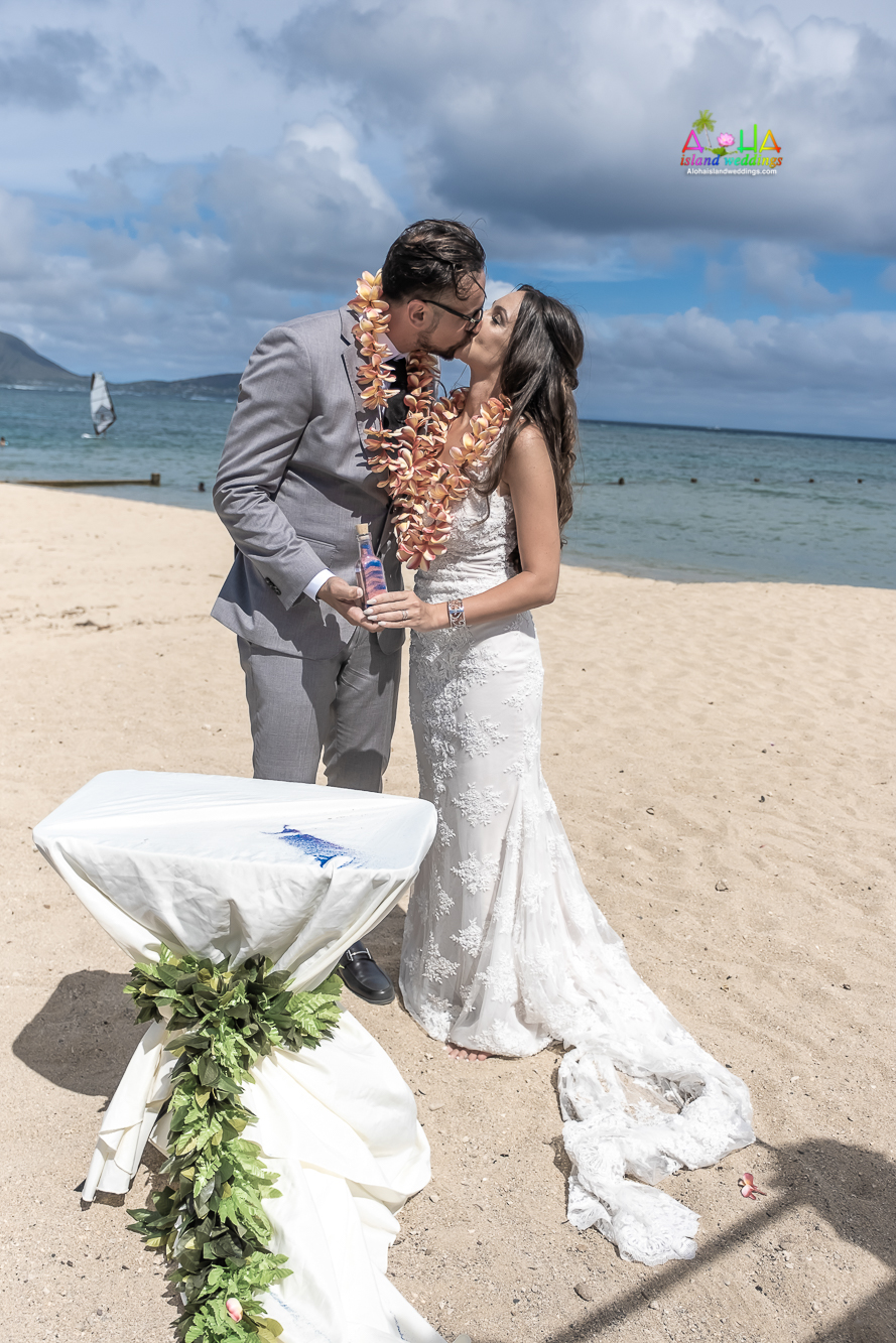 The sand ceremony symbolizes the unity of the bride and groom and/or the joining of their families-7