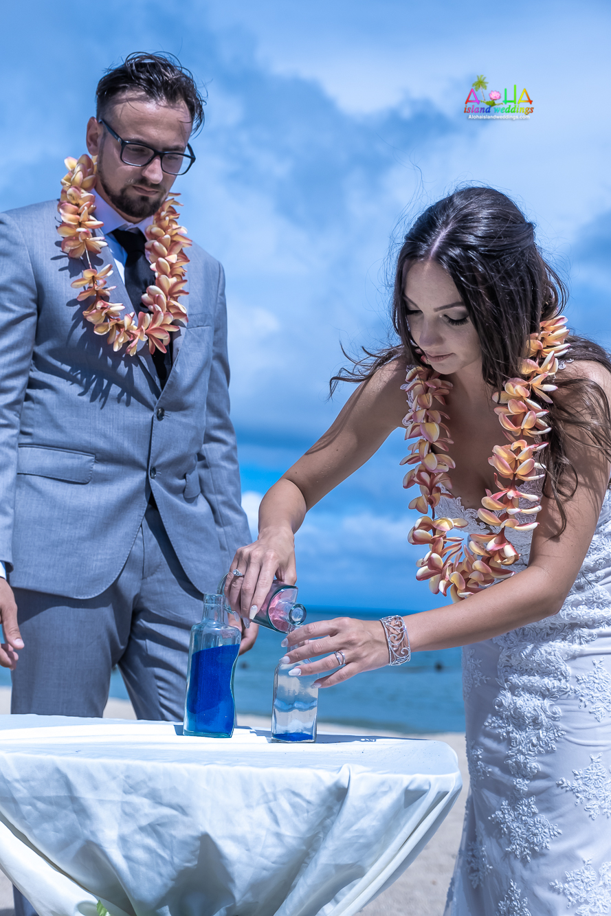 The sand ceremony symbolizes the unity of the bride and groom and/or the joining of their families-2