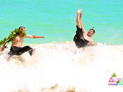 groom and best man jump in the waves.jpg