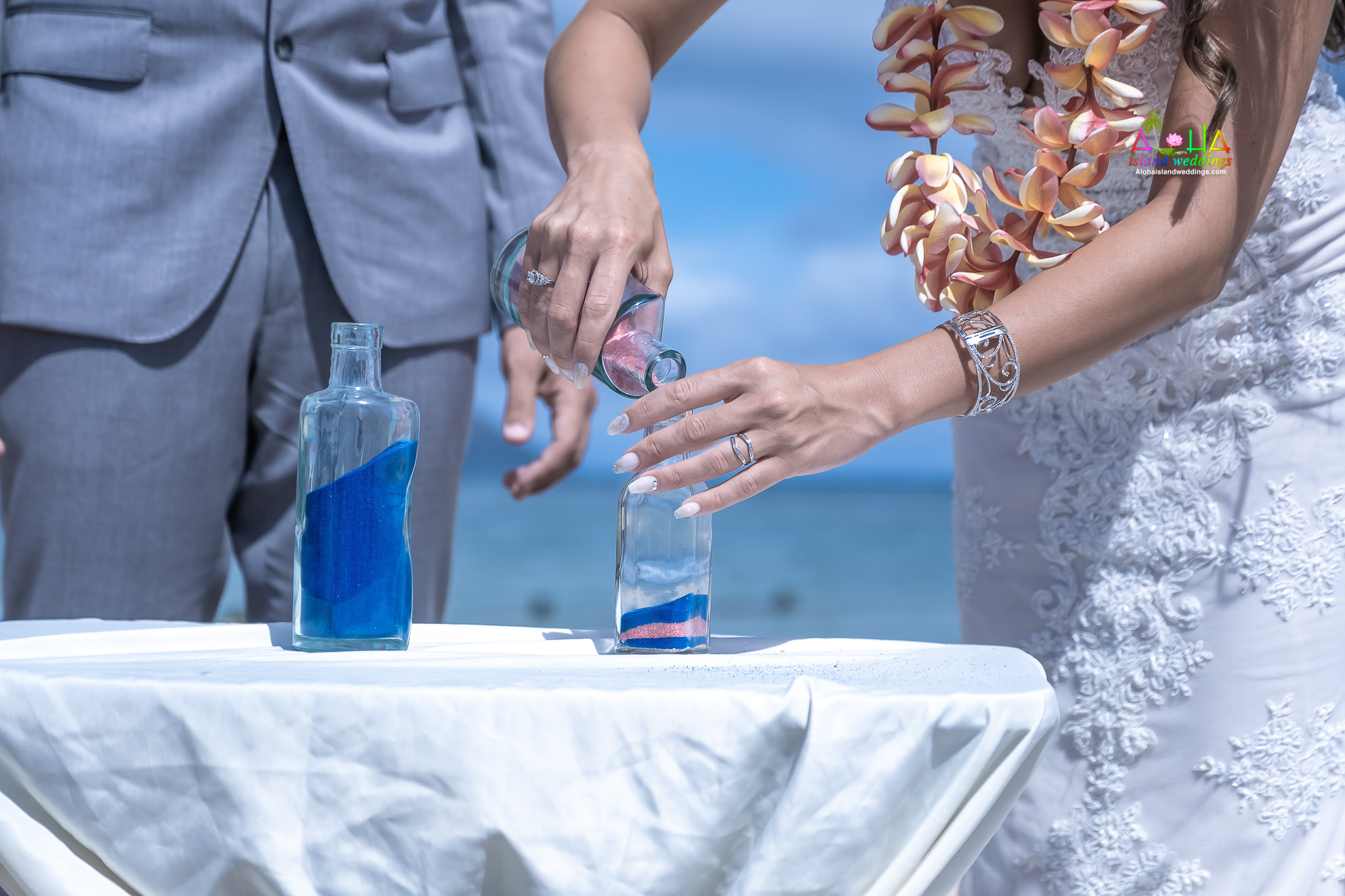 The sand ceremony symbolizes the unity of the bride and groom and/or the joining of their families-1