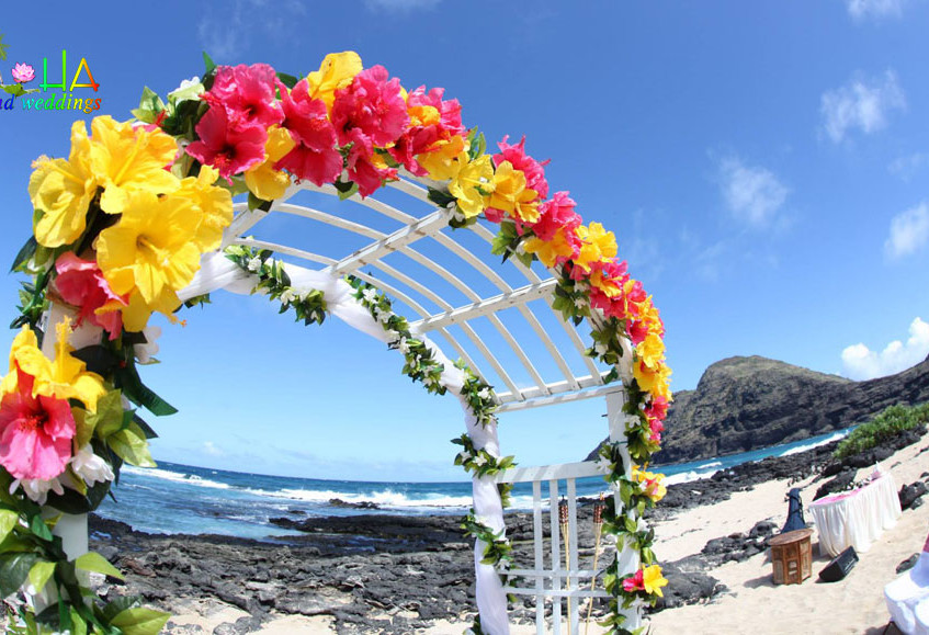 white wedding arch with yellow and pink hibiscus for penny