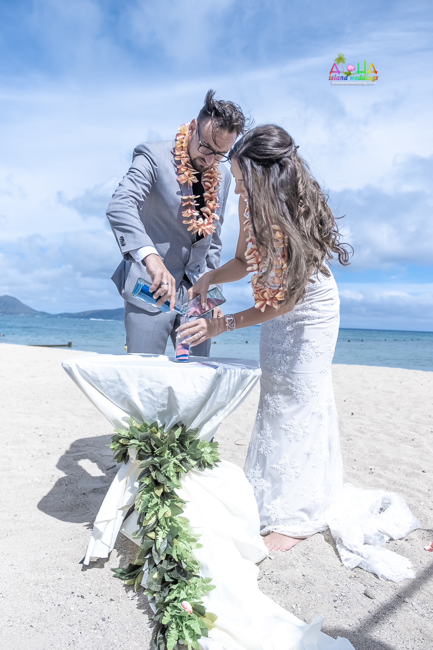 The sand ceremony symbolizes the unity of the bride and groom and/or the joining of their families-9