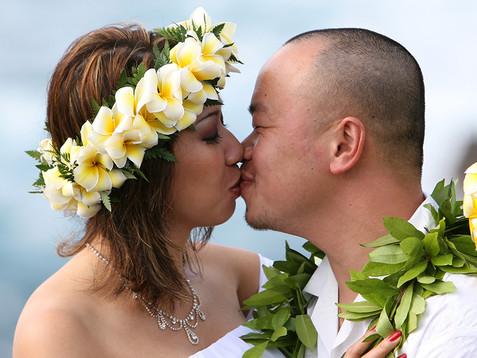 yellow plumeria haku lei in Hawaii.jpg