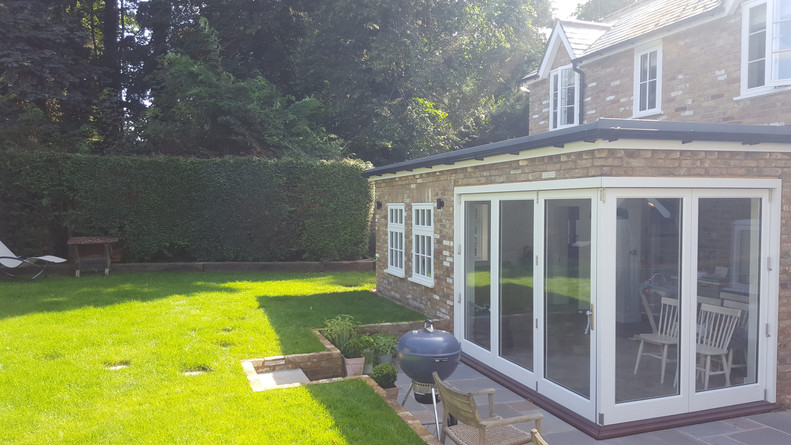 ascot-extension-rear-bi-fold-grass.jpg
