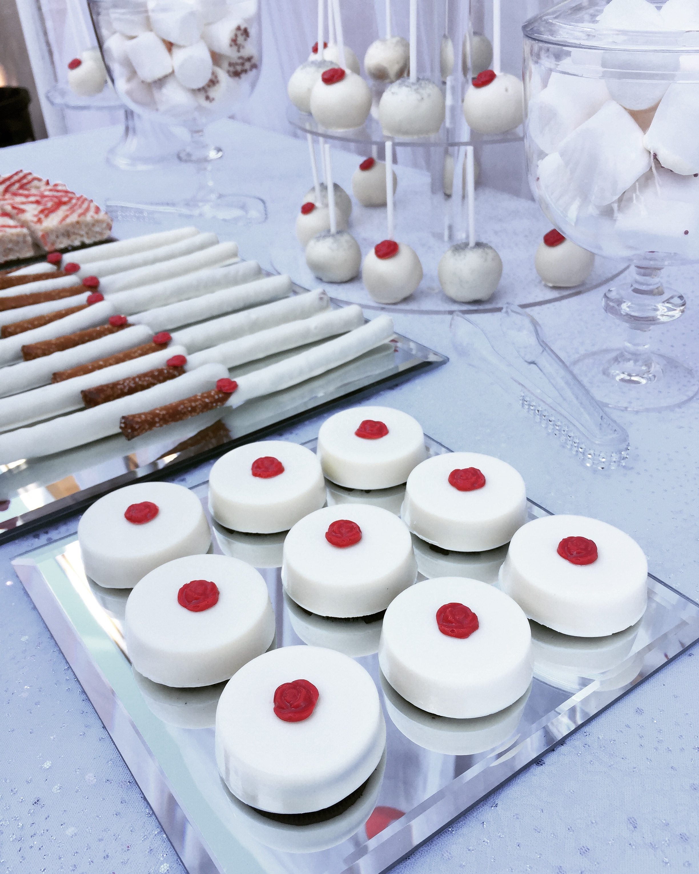 All white desserts w/ red roses