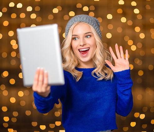 Portrait of a cheerful woman doing video