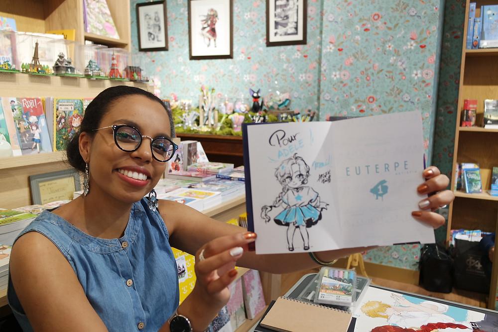 Art-of-K la mangaka d' Euterpe en dédicace au Renard Doré de Paris - Editions H2T