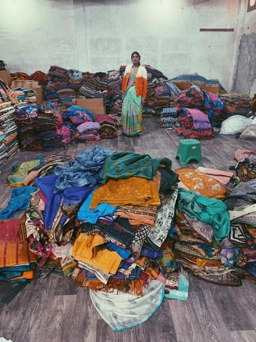 Piles of vintage Sarees