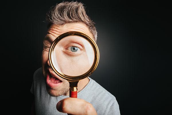 bigstock-man-see-through-magnifying-gla-