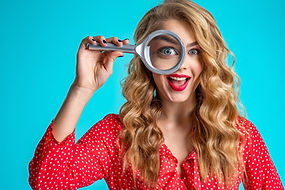 bigstock-Cheerful-blonde-holds-a-magnif-