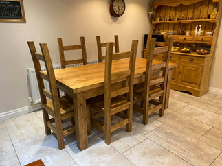 Large rustic table with a drawer in the end and our tall curved chairs
