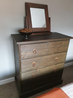 Rustic chest of drawers with a dark oak finish