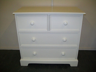 Painted 2 over 2 chest of drawers with a shaped plynth.