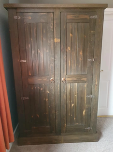 Rustic wardrobe with a dark oak finish