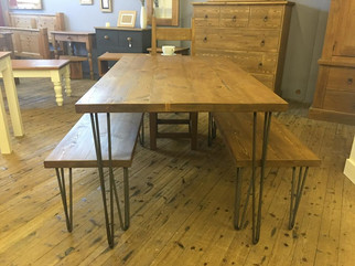 Rustic table and benches with hairpin legs.