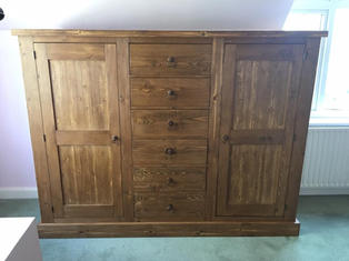 low rustic wardrobe with central drawers