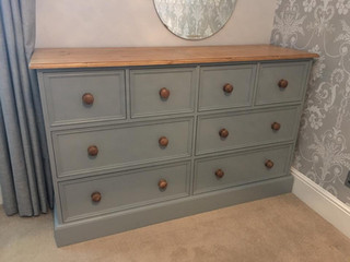 Large 8 drawer chest painted in a light grey colour.