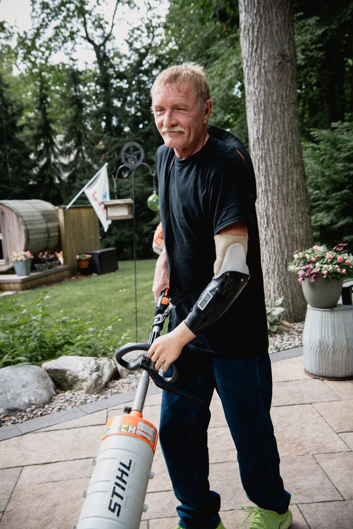 Steve using a leaf blower