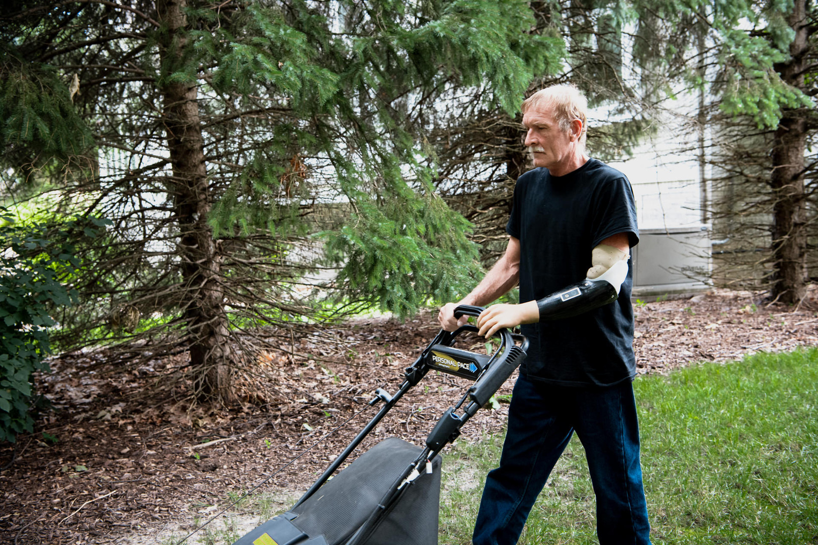 Steve mowing the lawn