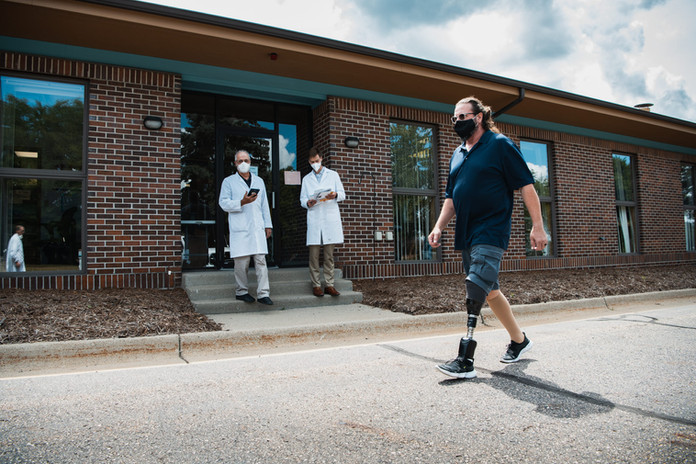 Todd S. testing the programming of his ankle outside the clinic