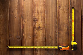 tape-measure-tools-on-wooden-background-