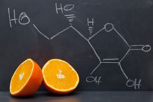 Structural formula of vitamin C on black