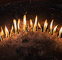 iStock-178742275_circle of small flames_