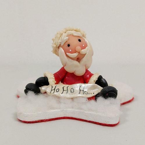 Santa sobre estrella